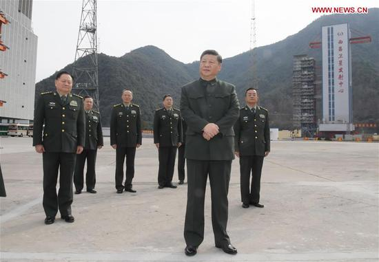 Chinese PresidentXi Jinping(front), also general secretary of the Communist Party of China Central Committee and chairman of the Central Military Commission, visits a satellite launch site at a military base in southwest China's Sichuan Province, Feb. 10, 2018. Xi visited the military base on Saturday ahead of the Spring Festival, which falls on Feb. 16 this year. He extended festival greetings to all officers and soldiers of thePeople's Liberation Armyand the armed police force, and all militia and reserve personnel. (Xinhua/Li Gang)