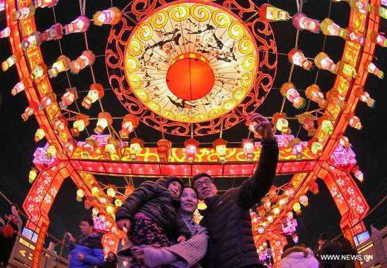 Tourists take selfie as visiting a lantern fair to greet the upcoming Lantern Festival in Zibo City, east China's Shandong Province, Feb. 27, 2018. The Lantern Festival falls on the 15th day of the first lunar month, or March 2 this year. (Xinhua/Tang Ke)
