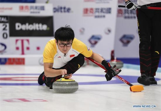 China's Zang Jialiang casts stone during an Olympic Qualification match of curling for 2018 Winter Olympics in Pyeongchang between men's teams from China and Italy, in Pilsen, the Czech Republic, on Dec. 6, 2017. China won 10-5. (Xinhua/Shan Yuqi)