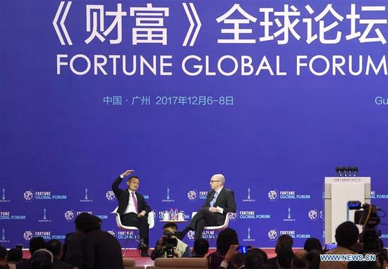 Jack Ma (L), founder and executive chairman of Alibaba Group, speaks at a thematic meeting entitled