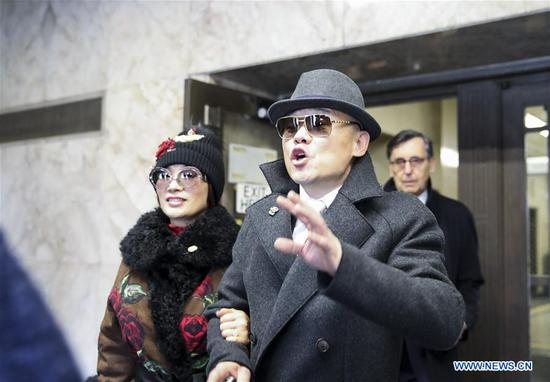 Zhou Libo (R) walks out of Nassau County Court after a court session in Nassau County, New York, the United States, Feb. 1, 2018. Chinese comedian Zhou Libo appeared in a court session with the judge and prosecutor here on Thursday. Zhou is charged with illegal possession of a handgun, possession of a controlled substance identified as crystal methamphetamine and driving while using a cellphone. (Xinhua/Wang Ying)