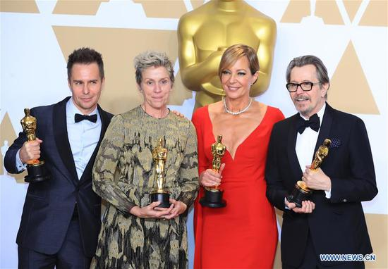 Oscar winners Sam Rockwell, Frances McDormand, Allison Janney and Gary Oldman (L to R) pose at press room of the 90th Academy Awards at the Dolby Theater in Los Angeles, the United States, on March 4, 2018. (Xinhua/Li Ying)