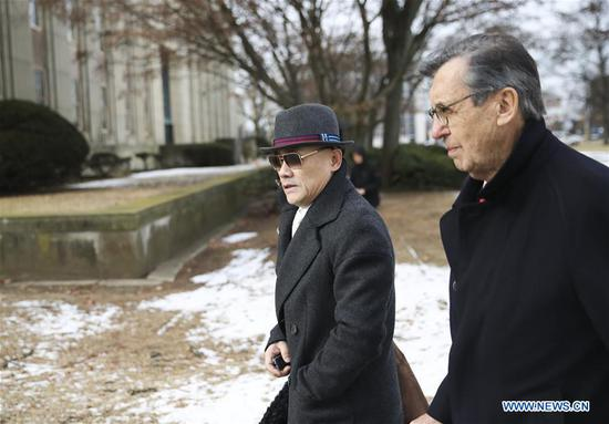 Zhou Libo (L) leaves Nassau County Court after a court session in Nassau County, New York, the United States, Feb. 1, 2018. Chinese comedian Zhou Libo appeared in a court session with the judge and prosecutor here on Thursday. Zhou is charged with illegal possession of a handgun, possession of a controlled substance identified as crystal methamphetamine and driving while using a cellphone. (Xinhua/Wang Ying)