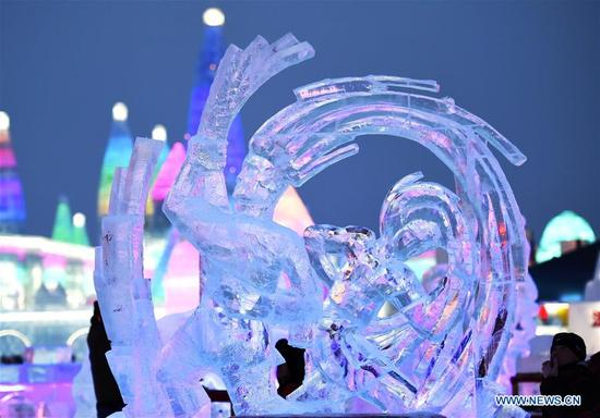 Ice sculptures are illuminated by coloured lights on the 2nd day of the 32nd Harbin international ice sculpture competition at Harbin Ice-Snow World in northeast China's Heilongjiang Province, Jan. 7, 2018. (Xinhua/Wang Jianwei)