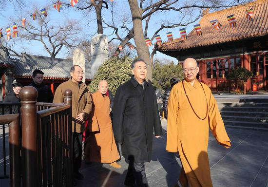 Chinese Vice Premier Wang Yang (2nd R), also a member of the Standing Committee of the Political Bureau of the Communist Party of China (CPC) Central Committee, visits the Buddhist Association of China in Beijing, capital of China, Feb. 6, 2018. Wang visited some national religious associations on Tuesday and extended New Year greetings to religious circles in China ahead of the Spring Festival. (Xinhua/Liu Weibing)