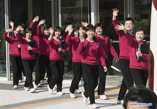 The Samjiyon orchestra members arrive at the Arts Center of Gangneung, South Korea, on Feb. 8, 2018. The Samjiyon orchestra from the Democratic People's Republic of Korea (DPRK) staged a performance in the South Korean city of Gangneung on Thursday night before the opening of the PyeongChang Winter Olympics. (Xinhua/Lee Sang-ho)