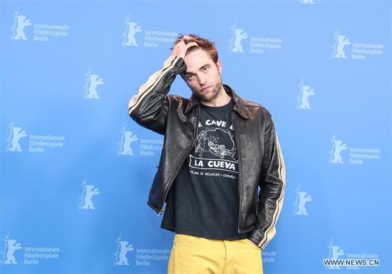 Actor Robert Pattinson poses for photos during the photocall of film