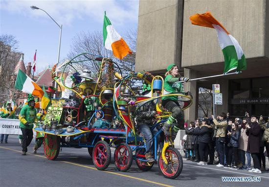 A colourful float is seen during the 2018 Toronto St. Patrick's Day Parade in Toronto, Canada, March 11, 2018. Thousands of people came out to celebrate the Irish history, culture and heritage by taking part in the 2018 Toronto St. Patrick's Day Parade on Sunday. (Xinhua/Zou Zheng)