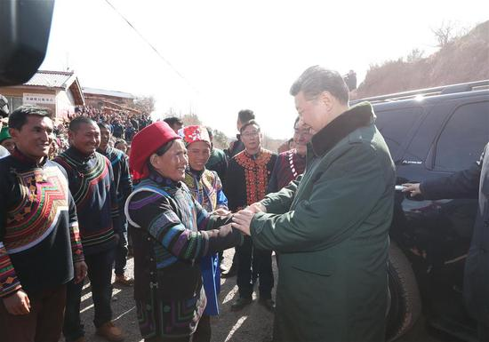 Chinese President Xi Jinping, also general secretary of the Communist Party of China Central Committee, bids farewell to villagers as he visits Sanhe Village of Sanchahe Township in Zhaojue County of Liangshan Yi Autonomous Prefecture, southwest China's Sichuan Province, Feb. 11, 2018. Xi made an inspection tour in Sichuan Province on Feb. 11. (Xinhua/Xie Huanchi)