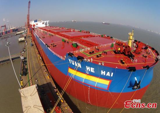 Shanghai Waigaoqiao Shipbuilding Co., Ltd. delivers its second-generation very large ore carrier (VLOC) Yuanhehai in Shanghai, Jan. 11, 2018. The 400,000-dwt mega ship is 362 meters long, 65 meters wide and 30.4 meters high. It's more economical, environment-friendly and safer than first-generation carriers, meeting the world's top standards. The shipbuilder will build more VLOCs for China Ore Shipping. (Photo: China News Service/Yin Liqin)