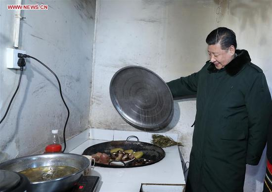 Chinese President Xi Jinping, also general secretary of the Communist Party of China Central Committee and chairman of the Central Military Commission, visits a villager's home in Huopu Village of Jiefang Township in Zhaojue County of Liangshan Yi Autonomous Prefecture, southwest China's Sichuan Province, Feb. 11, 2018. Xi made an inspection tour in Sichuan and extended greetings ahead of the Spring Festival, which falls on Feb. 16 this year. (Xinhua/Ju Peng)