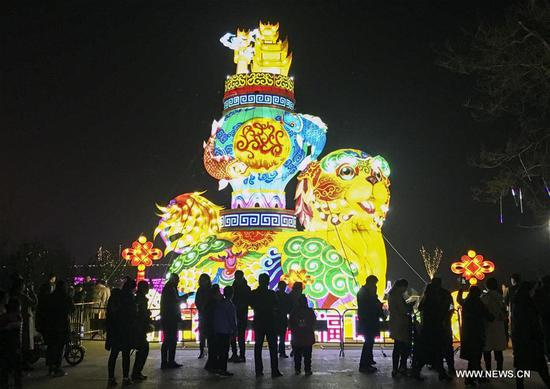 Tourists visit a lantern fair to greet the upcoming Lantern Festival in Pingyao County, north China's Shanxi Province, Feb. 27, 2018. The Lantern Festival falls on the 15th day of the first lunar month, or March 2 this year. (Xinhua/Liang Shengren)