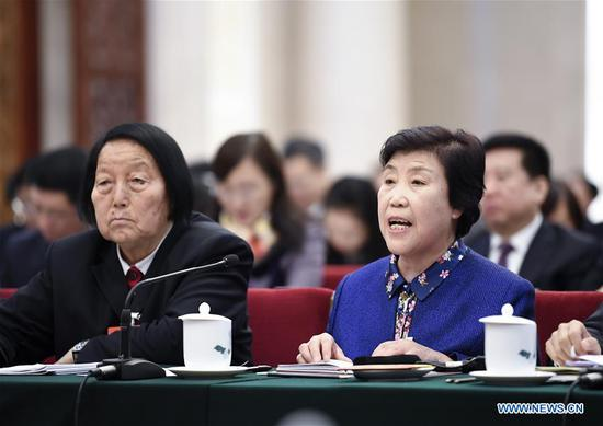Shen Jilan (L) and Guo Fenglian, deputies to China's 13th National People's Congress (NPC) from Shanxi Province, attend a panel discussion of the annual NPC session in Beijing, capital of China, March 8, 2018. The International Women's Day falls on March 8, during the ongoing sessions of China's National People's Congress (NPC) and the National Committee of the Chinese People's Political Consultative Conference (CPPCC). (Xinhua/Yan Yan)