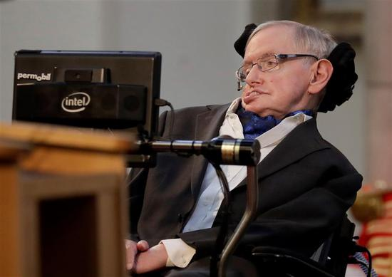 In this file photo, Britain's physicist Stephen Hawking delivers a keynote speech as he receives the Honorary Freedom of the City of London during a ceremony at the Guildhall in the City of London on March 6, 2017.