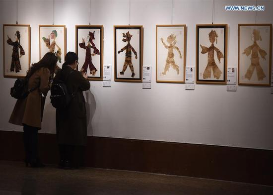 People visit the exhibition of New Vision of Chinese Art 2018 in Beijing, capital of China, March 12, 2018. The exhibition, displaying artworks supported by China National Arts Fund, kicked off here on Monday. (Xinhua/Luo Xiaoguang)