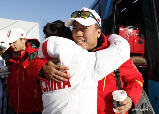 Chairwoman of China Figure Skating Association Shen Xue (L) hugs her husband, head coach of China's figure skating team Zhao Hongbo upon his arrival at Olympic Village in Gangneung, South Korea, Feb. 6, 2018. The 2018 PyeongChang Olympic Winter Games will kick off here on Feb. 9. (Xinhua/Han Yan)