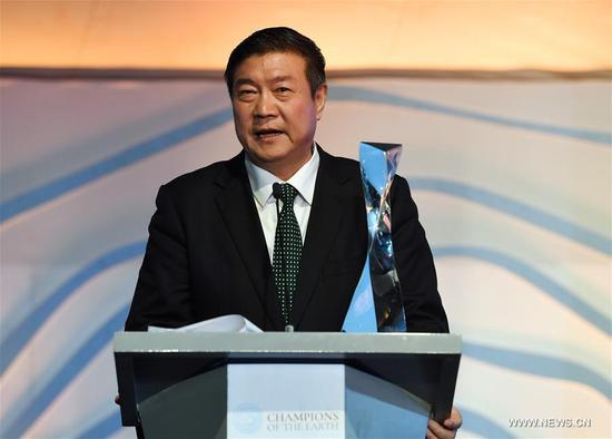 Chairman of Elion Resources Group Wang Wenbiao speaks during an awarding ceremony in Nairobi, Kenya, on Dec. 5, 2017. Wang Wenbiao was honored the Champion of the Earth award during the UN Environment Assembly (UNEA3) being held on Dec. 4-6 in Nairobi, Kenya. (Xinhua/Chen Cheng)