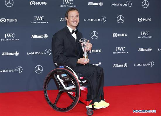 Swiss wheelchair racer Marcel Hug poses with the