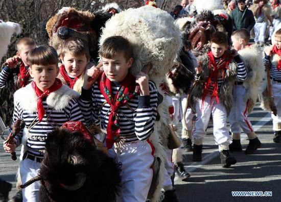 Locals in costumes attend the bellman parade in Rijeka, Croatia, on Feb. 11, 2018. Bellman parade is a Croatian tradition to drive out evil spirits over the winter months and to usher in the beginning of spring. (Xinhua/Relja Dusek)