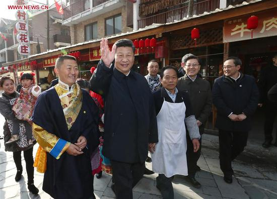 Chinese President Xi Jinping (2nd L, front), also general secretary of the Communist Party of China Central Committee and chairman of the Central Military Commission, visits Yingxiu Town of Wenchuan County, southwest China's Sichuan Province, Feb. 12, 2018. Xi made an inspection tour in Sichuan and extended greetings ahead of the Spring Festival, which falls on Feb. 16 this year. (Xinhua/Ju Peng)