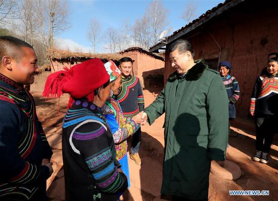 Chinese President Xi Jinping, also general secretary of the Communist Party of China Central Committee, visits the homes of impoverished villagers of the Yi ethnic group who live deep in the Daliang Mountains of Zhaojue County, Sichuan Province in southwest China, Feb. 11, 2018. Xi asked the villagers about their lives and discussed poverty alleviation with local officials and villagers on Sunday. (Xinhua/Xie Huanchi)