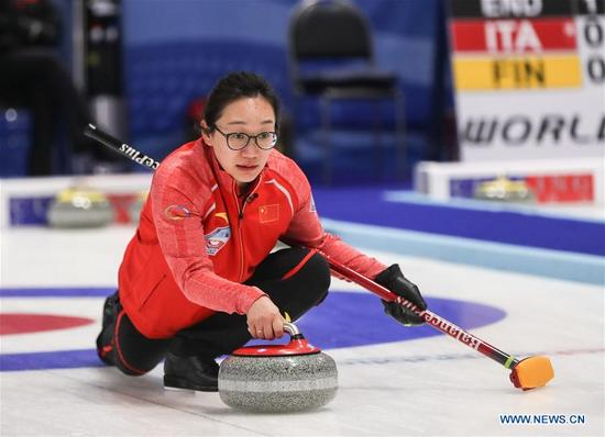 China's Zhou Yan casts stone during an Olympic Qualification match of curling for 2018 Winter Olympics in Pyeongchang between women's teams from China and Latvia in Pilsen, the Czech Republic, on Dec. 6, 2017. China won 11-5. (Xinhua/Shan Yuqi)