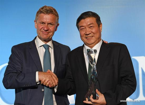 Chairman of Elion Resources Group Wang Wenbiao (R) poses with Erik Solheim, Executive Director of the UN Environment Programme (UNEP) during an awarding ceremony in Nairobi, Kenya, on Dec. 5, 2017. Wang Wenbiao was honored the Champion of the Earth award during the UN Environment Assembly (UNEA3) being held on Dec. 4-6 in Nairobi, Kenya. (Xinhua/Chen Cheng)