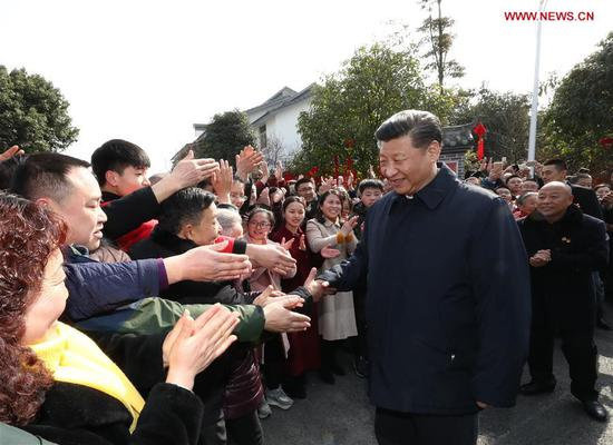 Chinese President Xi Jinping, also general secretary of the Communist Party of China Central Committee and chairman of the Central Military Commission, shakes hands with local people in Zhanqi Village of Pidu District in Chengdu, southwest China's Sichuan Province, Feb. 12, 2018. Xi made an inspection tour in Sichuan on Feb. 12. (Xinhua/Ju Peng)