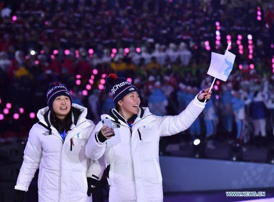 The Democratic People's Republic of Korea (DPRK) and South Korea march together under a unified Korean flag during the opening ceremony of the 2018 PyeongChang Winter Olympic Games at PyeongChang Olympic Stadium in PyeongChang, South Korea, Feb. 9, 2018. (Xinhua/Lui Siu Wai)