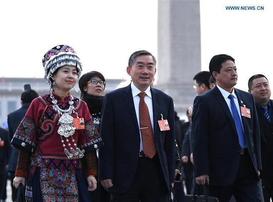 Deputies to the 13th National People's Congress (NPC) walk to the Great Hall of the People for the opening meeting of the first session of the 13th NPC in Beijing, capital of China, March 5, 2018. (Xinhua/Yan Yan)