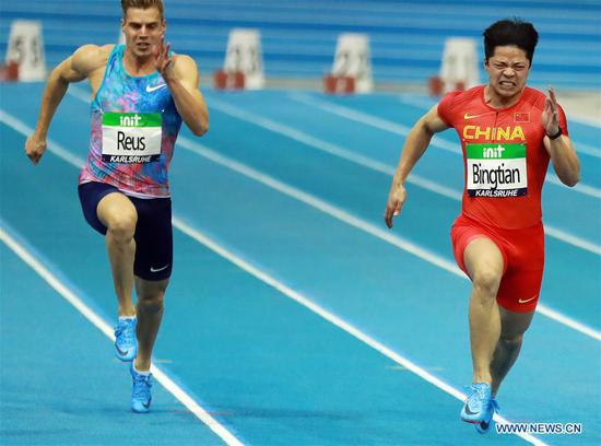 Su Bingtian (R) of China competes during the Men's 60m final of the 2018 IAAF World Indoor Tour in Karlsruhe, Germany, on Feb. 3, 2018. Su Bingtian claimed the title with 6.47 seconds.(Xinhua/Luo Huanhuan)