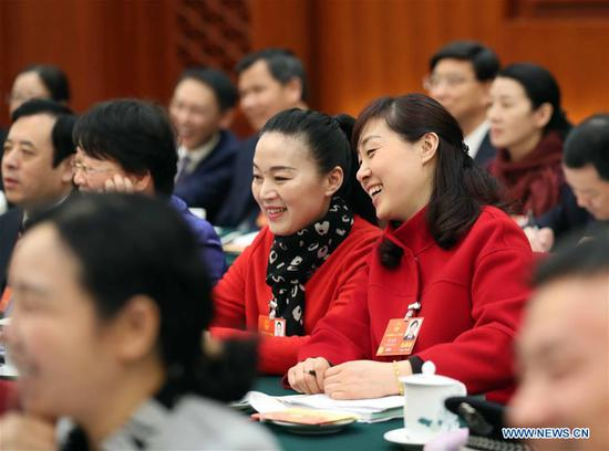 Chen Jianyin (R) and Chen Jing, deputies to China's 13th National People's Congress (NPC) from Anhui Province, attend a panel discussion of the annual NPC session in Beijing, capital of China, March 8, 2018. The International Women's Day falls on March 8, during the ongoing sessions of China's National People's Congress (NPC) and the National Committee of the Chinese People's Political Consultative Conference (CPPCC). (Xinhua/Liu Weibing)