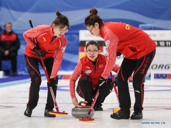 China's Wang Bingyu (C) casts stone during an Olympic Qualification match of curling for 2018 Winter Olympics in Pyeongchang between women's teams from China and Latvia in Pilsen, the Czech Republic, on Dec. 6, 2017. China won 11-5. (Xinhua/Shan Yuqi)