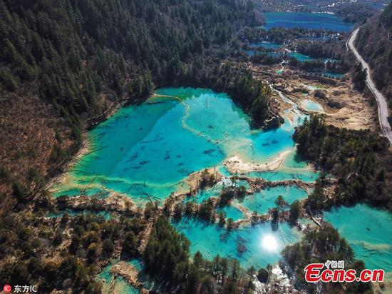 China's Jiuzhaigou national park, one of Sichuan Province's UNESCO World Heritage Sites, will partially reopen to tourists on March 8 after being hit by a 7.0 magnitude earthquake in August 2017. Some of the park's popular sites, including the Nuorilang Waterfall, which was reduced to a pile of mud in the earthquake, Long Lake, Mirror Lake, Five-Colour Lake and the Shuzheng Lakes, will once again be open to the public. To protect the site, only 2,000 visitors will be admitted to the park each day, whereas some 20,000 tourists were allowed in daily before the earthquake. (Photo/IC)
