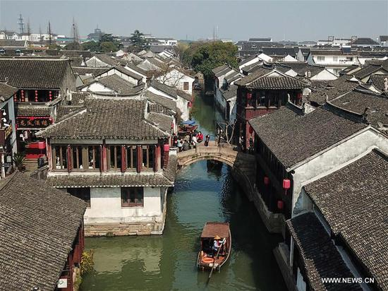 Tourists take sightseeing boats on the river in the ancient town of Zhouzhuang in Suzhou City, east China's Jiangsu Province, March 10, 2018. As temperature rises, the water town of Zhouzhuang becomes hot tourist destination. (Xinhua/Li Bo)