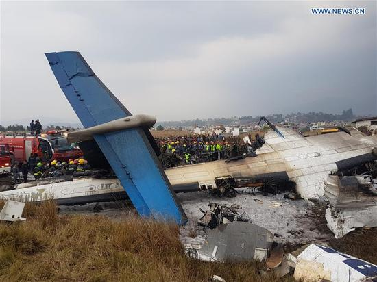 Photo taken on March 12, 2018 shows the crash-landing site in Kathmandu, Nepal. A passenger plane of the US-Bangla Airlines crashed at Nepal's Tribhuvan International Airport (TIA) on Monday, with dozens feared dead and at least 17 people injured. (Xinhua)