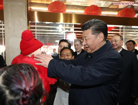 Chinese President Xi Jinping, also general secretary of the Communist Party of China Central Committee and chairman of the Central Military Commission, greets a child in Yingxiu Town of Wenchuan County, southwest China's Sichuan Province, Feb. 12, 2018. Xi made an inspection tour in Sichuan on Feb. 12. (Xinhua/Ju Peng)