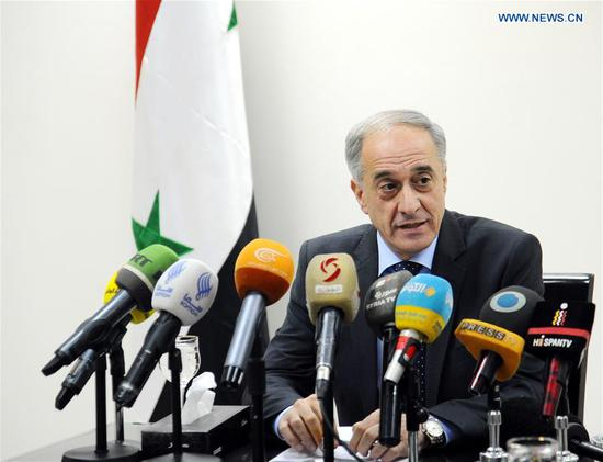 Ayman Soussan, an assistant of Syria's Foreign Minister, speaks at a press conference in Damascus, Syria, Feb.13, 2018. The Syrian government said Tuesday it rejects any formation of a constitutional committee by the UN out of the context of the Syrian talks in Sochi held last month, according to state news agency SANA. (Xinhua/Ammar Safarjalani)