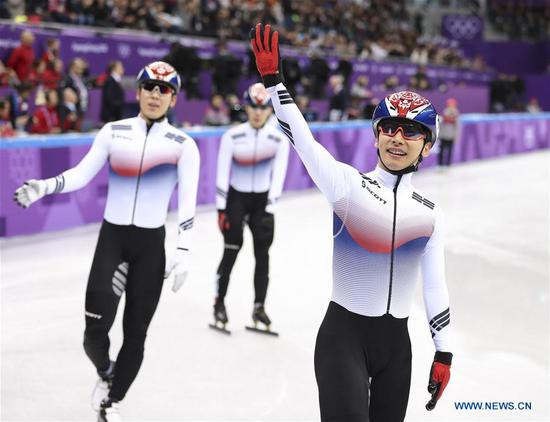 South Korea's skaters celebrate after finishing men's 5000m relay heat event of short track speed skating at the Pyeongchang 2018 Winter Olympic Games at Gangneung Ice Arena, Gangneung, South Korea, Feb. 13, 2018. Team South Korea advanced to next round in a time of 6:34.510 and set a new Olympic record. (Xinhua/Han Yan)