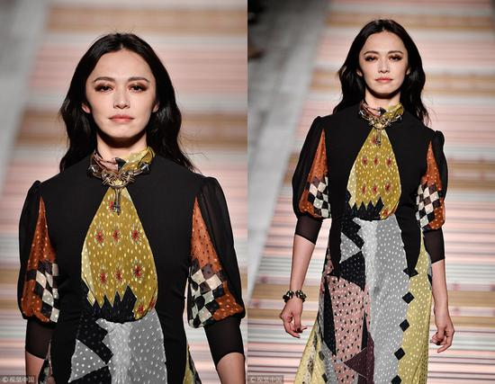 Chinese actress Yao Chen presents a creation by Etro during the 2018 Milan Fashion Week in Milan, February 23, 2018. [Photo/VCG]