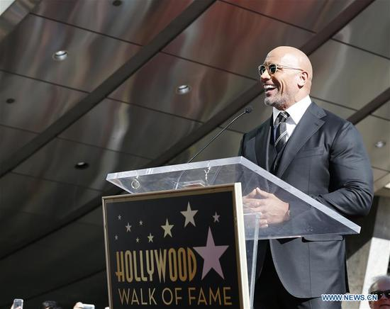 Dwayne Johnson speaks at his Hollywood Walk of Fame Star ceremony in Los Angeles, the United States, Dec. 13, 2017. Dwayne Johnson was honored with a star on the Hollywood Walk of Fame on Monday. (Xinhua/Li Ying)
