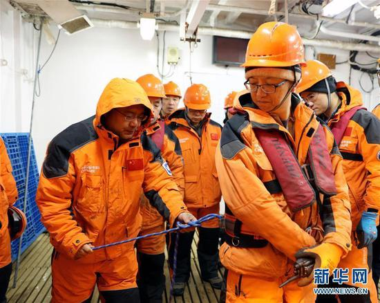 Members of China's 34th Antarctic expedition make preparations for a marine survey on the research icebreaker Xuelong in the Amundsen Sea, March 2, 2018. This marks the first time Chinese research has been conducted in this area.