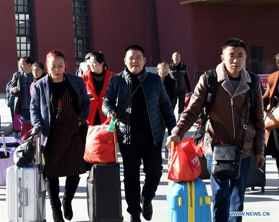 Passengers arrive at Lhasa Railway Station in Lhasa, southwest China's Tibet Autonomous Region, March 12, 2018. China's 2018 Spring Festival travel season came to an end on Monday. The period, also known as