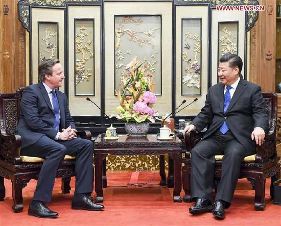 Chinese President Xi Jinping(R) meets with former British Prime Minister David Cameron in Beijing, capital of China, Jan. 11, 2018. (Xinhua/Li Xueren)