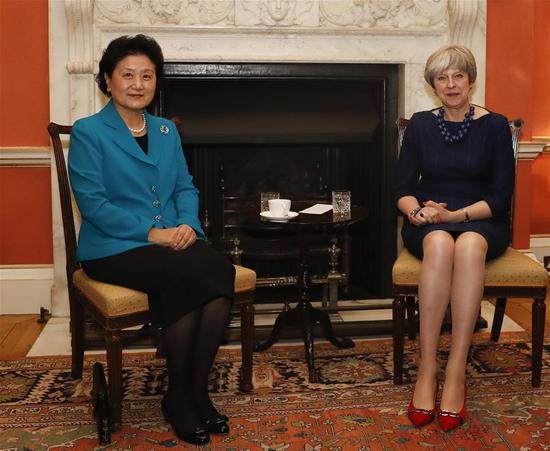 British Prime Minister Theresa May (R) meets with visiting Chinese Vice Premier Liu Yandong in London Dec. 5, 2017. Both sides pledged to strengthen people-to-people and cultural exchanges to enhance the social foundation of bilateral relations. (Xinhua/Han Yan)''-