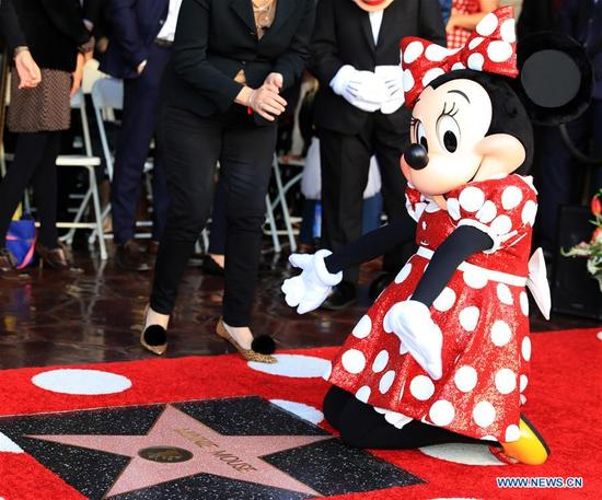 Disney character Minnie Mouse attends a star honoring ceremony on the Hollywood Walk of Fame in Los Angeles, the United States, Jan. 22, 2018. Minnie Mouse was honored with a star on the Hollywood Walk of Fame on Monday. (Xinhua/Li Ying)