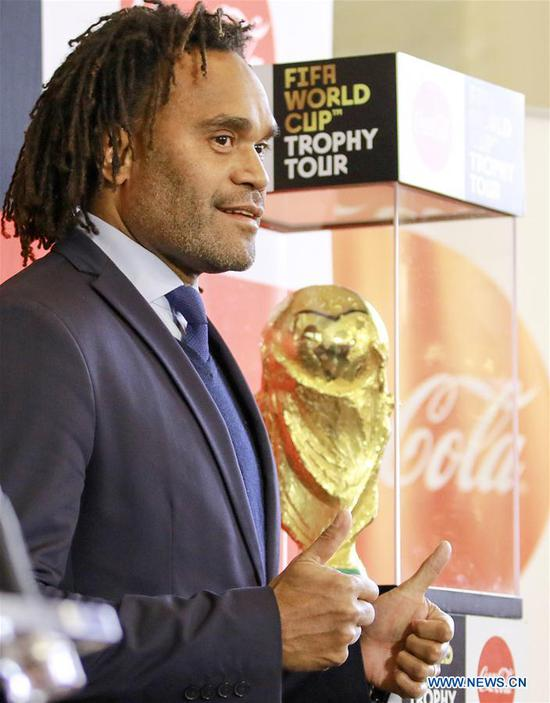 Former French player Christian Karembeu gestures as he presents the FIFA World Cup Trophy during a ceremony in Yerevan, Armenia, on Feb. 7, 2018. The FIFA World Cup trophy arrived in Yerevan on Wednesday as part of its worldwide tour ahead of the 2018 FIFA World Cup to be staged in Russia. (Xinhua/Gevorg Ghazaryan)