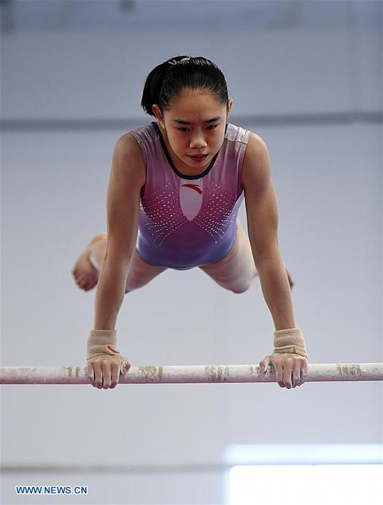 Liu Tingting, a member of China's women gymnastic team, is seen during training at Chow's Gymnastics and Dance Institute in West Des Moines, Iowa, the United States, on Dec. 27, 2017. Four Chinese women gymnasts have been attending a 20-day training program since Dec. 11. (Xinhua/Yin Bogu)