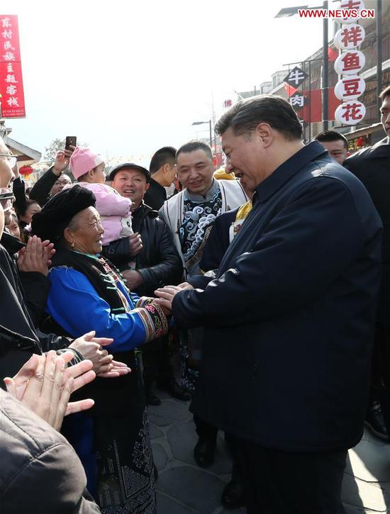 Chinese President Xi Jinping (R, front), also general secretary of the Communist Party of China Central Committee and chairman of the Central Military Commission, talks with local people in Yingxiu Town of Wenchuan County, southwest China's Sichuan Province, Feb. 12, 2018. Xi made an inspection tour in Sichuan on Feb. 12. (Xinhua/Ju Peng)