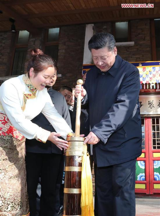 Chinese President Xi Jinping (R), also general secretary of the Communist Party of China Central Committee and chairman of the Central Military Commission, makes buttered tea in Yingxiu Town of Wenchuan County, southwest China's Sichuan Province, Feb. 12, 2018. Xi made an inspection tour in Sichuan on Feb. 12. (Xinhua/Ju Peng)